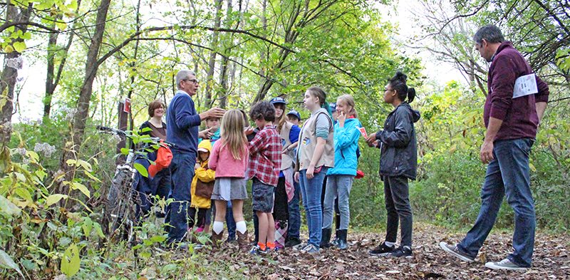 In this photo from 2018, Walk Walton participants listen to a presentation by naturalist Dave Ward. (Chronicle file photo)