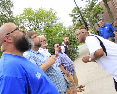 State Rep. Will Davis, right, examines the whiskers of competitors in the beard contest at the Homewood Ice Cream Social on July 22.