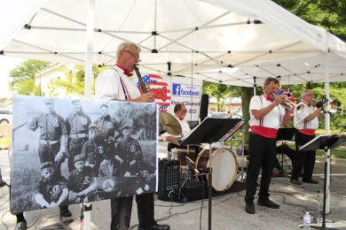 The Kings of Dixieland perform during the ice cream social with an historical photo in the foreground.