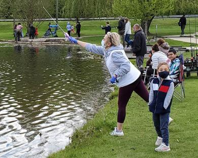 Figen Karadogan casts a line during the fishing derby at Dolphin Lake on Saturday. (EC)