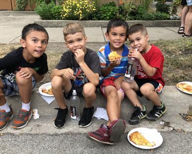 Having fun at Homewood's Giant Block Party are Andrew Cudiamat, 7, Jonah Maldonado, 7, Alex Cudiamat, 5, and Caleb Maldonado, 4. (MT)
