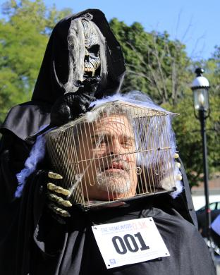 The head of Chris Loudon appears to be conveyed by Death himself. Loudon said he hadn't really thought through the whole eating and drinking aspect of the costume when he put his head in a cage.