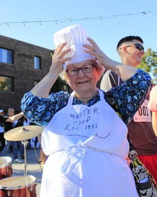 "Lillian Goodman, a Homewood resident for about 64 years, adjusts her master chef's hat. She presided over a team of family members who participated in the event. ""I think this is a terrific idea,"" she said."