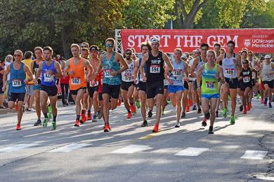 Runners begin the Hidden Gem Half Marathon, setting out west on Flossmoor Road.
