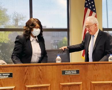 Mayor Richard Hofeld, right, welcomes new trustee Vivian Harris-Jones to her seat on the board. (EC)