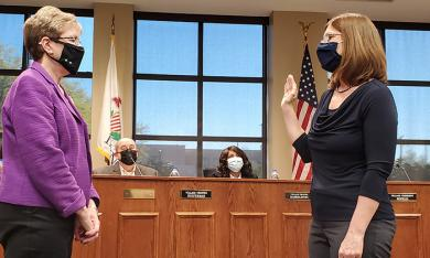 Village Clerk Marilyn Thomas, left, swears in Nancy Adams as executive assistant in the village manager's office. (EC)