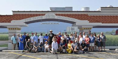 Chicago Region Porsches Club members pose June 16 in front of the Dixie Highway mural in the 18200 block of Dixie Highway in Homewood. (Provided photo from Jeff Brown/Chicago Region Porsches Club)