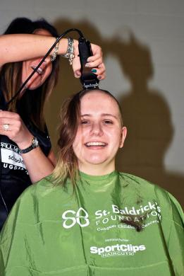 Riley Farkos of Homewood gets her head shaved by stylist Tracy Stevenson during the St. Baldrick's Day event at Parker Junior High.