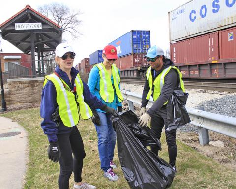 The Harwood Avenue cleanup crew, from left, are Allisa Opyd, Janet Hernandez and Camson Addenuga.