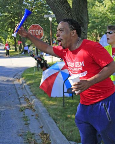 Atukwe Newell shouts himself hoarse cheering the Hidden Gem runners.