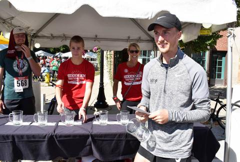 Alan Peterson of Chicago picks up his award for finishing first overall in the Hidden Gem Half Marathon in Flossmoor.