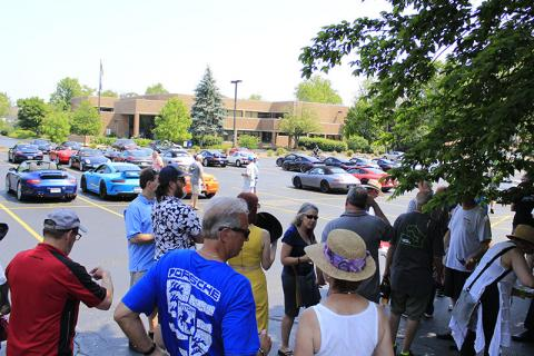 Members of the Chicago Region Porsche Club relax in the shade at St. Joseph School following a tour of Homewood's Richard Haas murals.