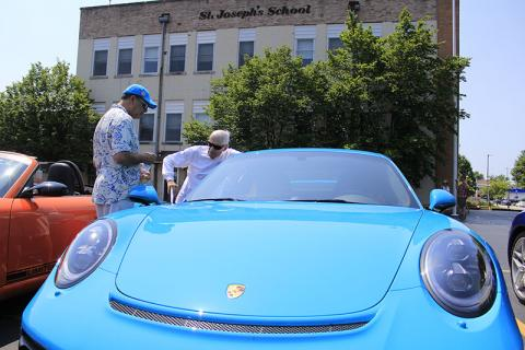 A couple of Chicago Region Porsche Club members talk during a visit to Homewood.