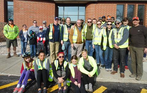 Volunteers gather at Flossmoor village hall to tackle cleanup and tree-planting projects. (Provided photo by Dave Ward)